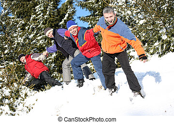 Best friends pull each other on the snow