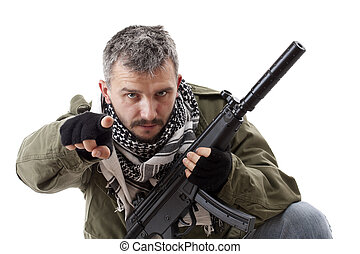 Terrorist with rifle pointing his finger for you, isolated...