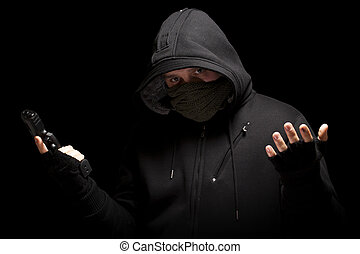 Thief with gun - isolated on black background