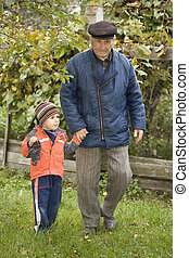Generation - Portrait of small boy helping a old man on...