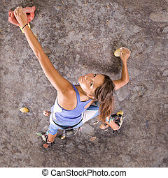 girl climbing - Pretty, young, athletic girl climbing on an...