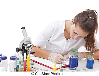 Serious female scientist - Scientist and microscope in...