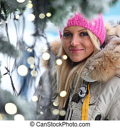 woman and bokeh - woman in winter hat and holyday bokeh