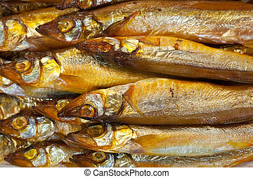 golden smoke-dried fish - background of golden smoke-dried...