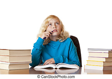 School girl sitting on desk thinking about homework problem....