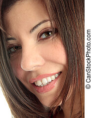 Smiling female face closeup - A closely cropped face of a...