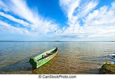 boat on summer lake bank - Old wooden fishing boat on summer...