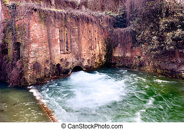 water mill - water flowing from an old water mill