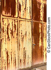 rusted main door - main entrance of abandoned industry -...