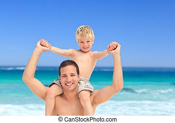 Father giving son a piggyback
