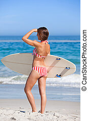Woman with her surfboard