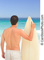Man with his surfboard