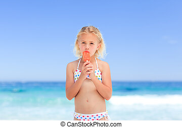 Little girl eating her ice cream