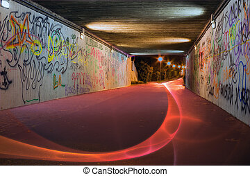 light painting - patterns of light in the underpass -...