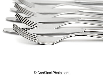 close up of a knife and fork on white background