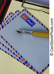 airmail - clipboard with letter paper and airmail envelopes