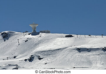 astronomical observatory on top of a snowy mountain