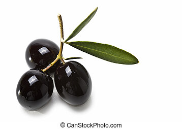 Three premium black olives. - Olives with leaves isolated on...