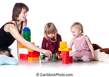 Children with mother playing with blocks isolated on white