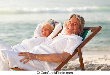 Elderly couple relaxing in their de