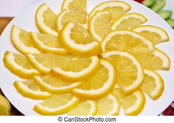 Slices of lemon on a plate