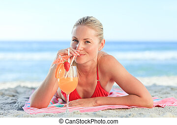 Cute woman drinking her cocktail