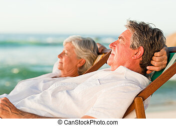 Elderly couple relaxing in their de