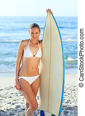 Sexy woman with her surfboard