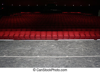 Red Theater seats - Red theater seats in small theater front...