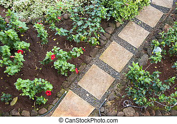 Pathway Stones in a Garden - red square pathway stones in a...