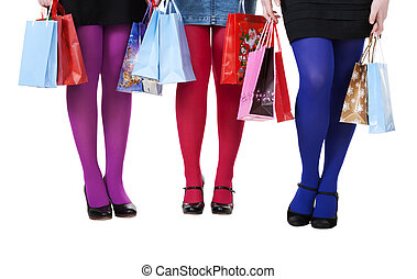 female legs in colorful tights with shopping bags