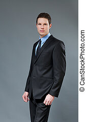Young businessman wearing dark suit - Young businessman...