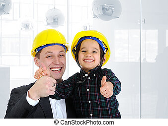 Happy boss and employee together, father and son engineers...