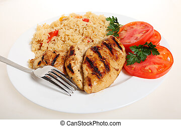 Cajun chicken and rice - A meal of spicy grilled cajun...