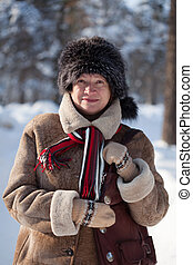 mature woman in winter park - Portrait of happy mature woman...
