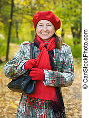 senior woman in autumn park - Portrait of senior woman in...
