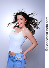 young woman in jeans and t shirt - smiling young woman in...