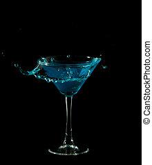 blue martini cocktail splashing