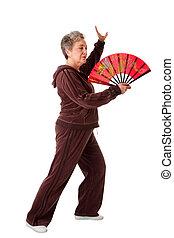 Senior woman doing Tai Chi Yoga exercise