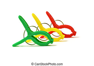 Colorful plastic clothes pegs on white background