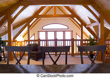 Timberframe loft area - Bathed in warm light, this photo...