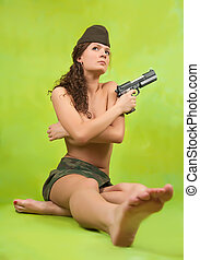 Sexy military woman with gun