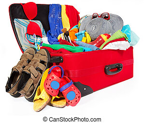 Family travel red suitcase packed for vacation - Travel red...