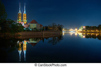 Wroclaw's night scene with cathedral and river