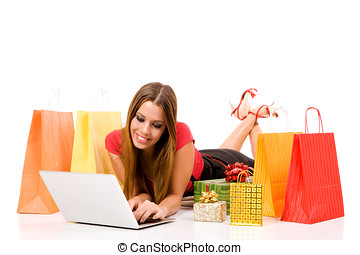 shopping over internet - Beautiful young woman shopping over...