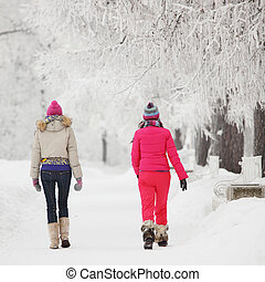 run by alley - two winter women run by snow frosted alley