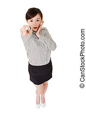 Surprised business woman of Asian pointing at you, isolated...