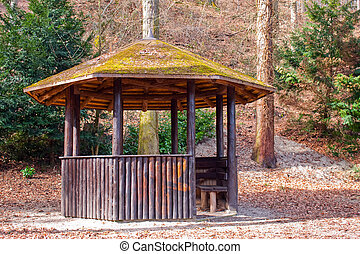 Cozy gazebo in the spring woods