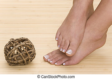 pedicure - beautiful feet with fresh manicured nails