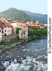 Houses on the river in Varallo Sesia, Piedmont, Italy